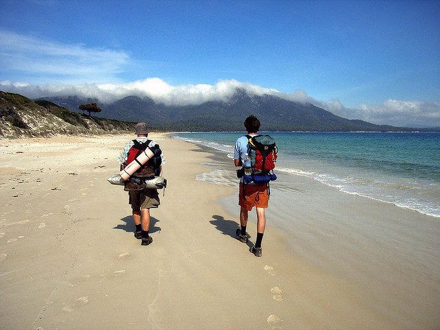 Backpackers on the beach.